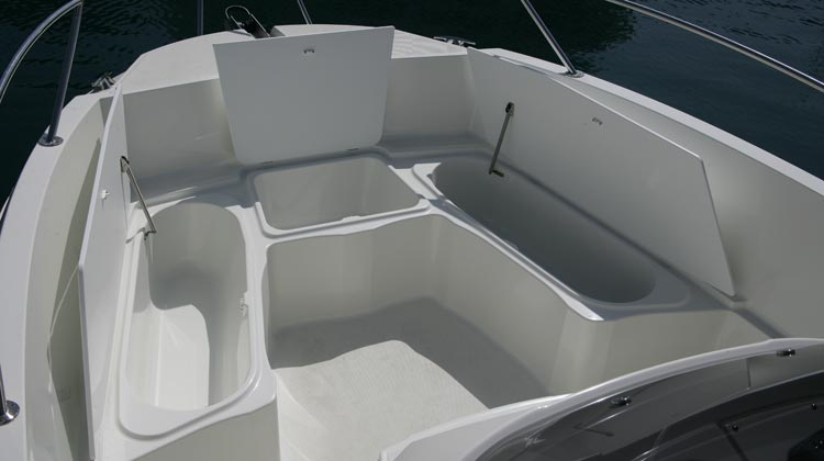 Large storage space with five drainable wells and stern bilge compartment