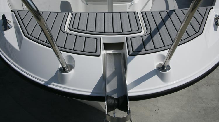 Anchor roller and concealed recess for optional windlass