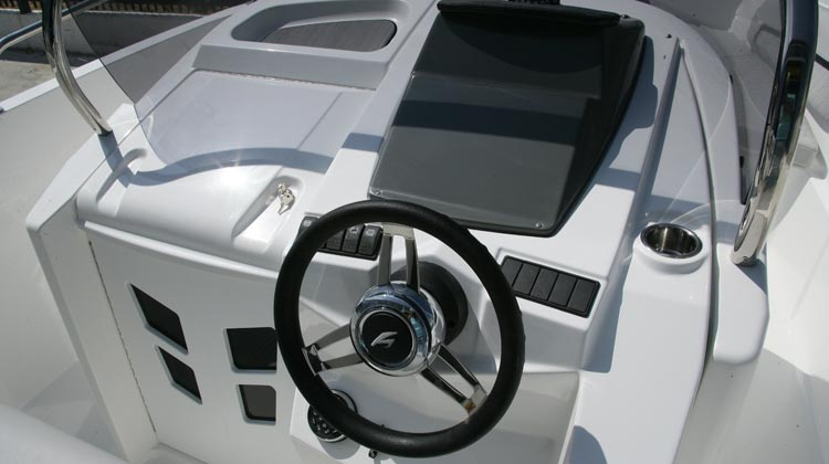 Marine grade electrical switches, compass, media/receiver, USB and 12V sockets and Karnic sport steering wheel