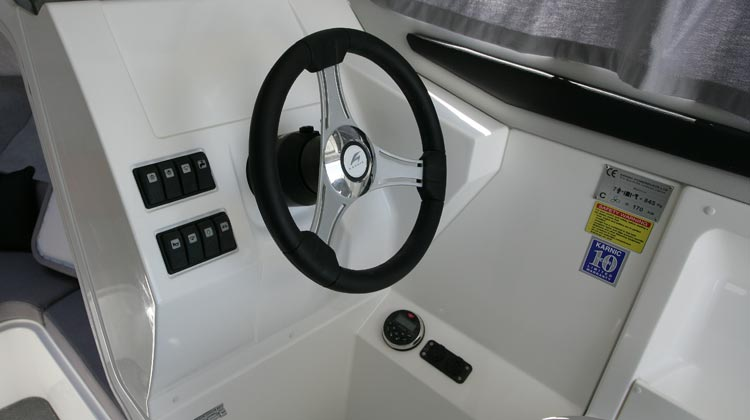 Marine grade electrical switches, compass, media/receiver, USB and 12V sockets
