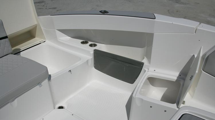 Stern and cockpit side drainable wells (2)
