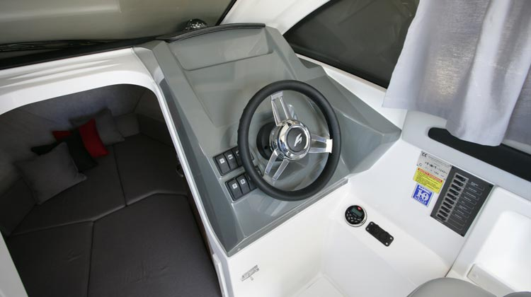 Marine grade electrical switches, compass, media/receiver, USB and 12V sockets and Karnic Deluxe steering wheel