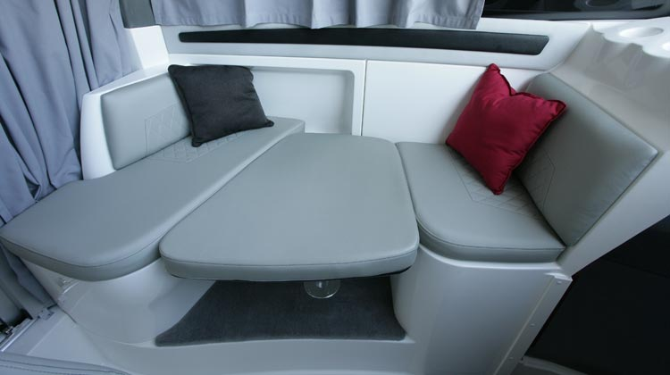 U-dinette with drop-down/removable table and optional cushion to convert to berth