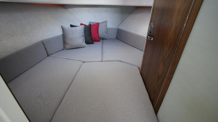 V-berth cabin accommodation for two adults with roof ventilation hatch and portlight
