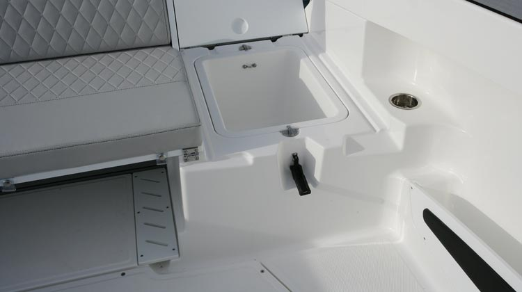 Stern, under seat wells (2) removable for extra storage and access to bilge