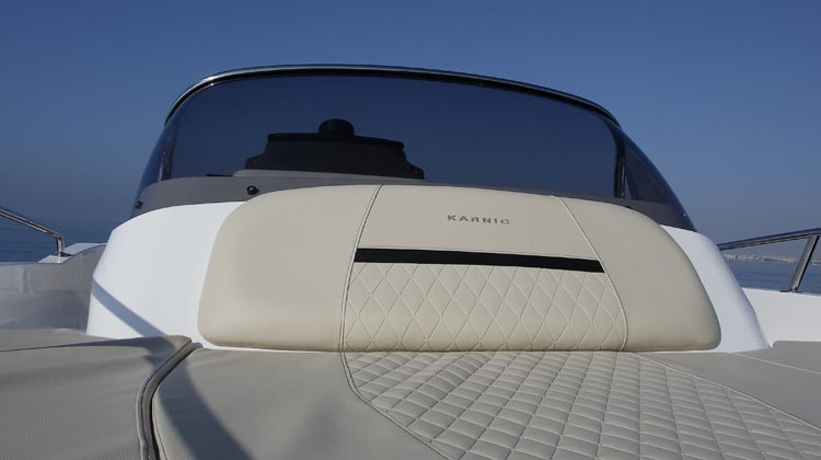 Styled console with double curvature windscreen and oval stainless steel rail