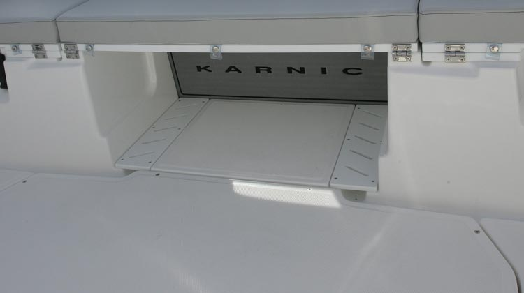 Self bailing cockpit with non-skid floor surfaces