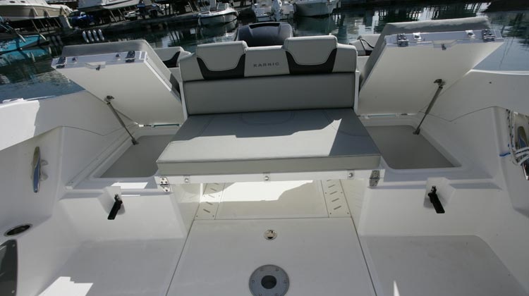 Standard drainable wells under stern seats and dedicated space for Igloo coolbox