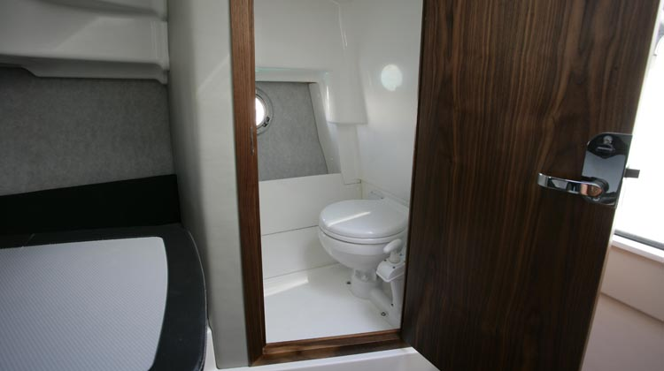 Separate toilet compartment with solid walnut frame and lockable door