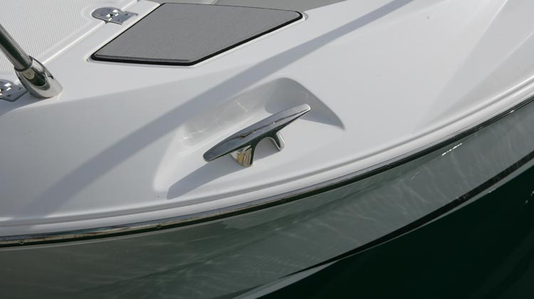 Heavy duty, stainless steel, styled cleats at bow and stern