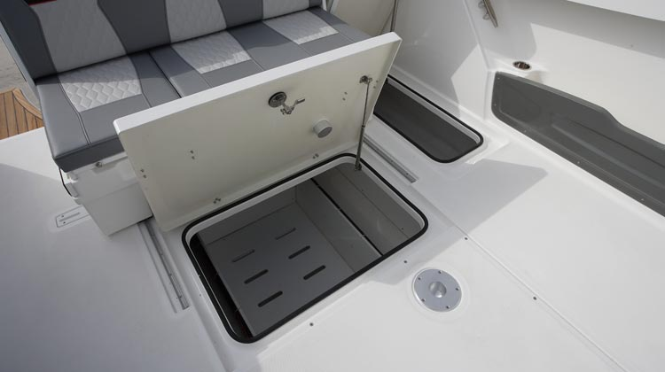 Large under sole storage compartments and cockpit side pockets that may accommodate even deck folding chairs