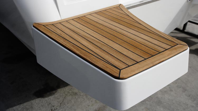 Standard swim platforms with concealed folding ladder with EVA foam padding and optional teak