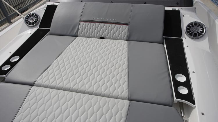 Fully cushioned sunbed at bow convertible to two-position inclined seat