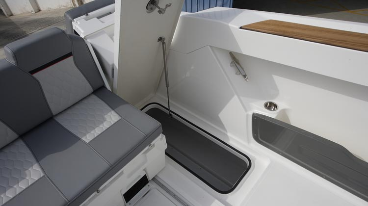 Stern port storage compartment