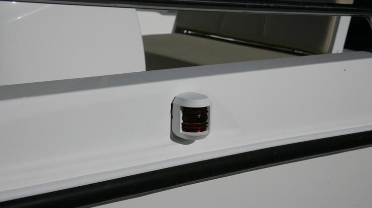 Fused electrics package with navigation lights and manual/automatic bilge pump